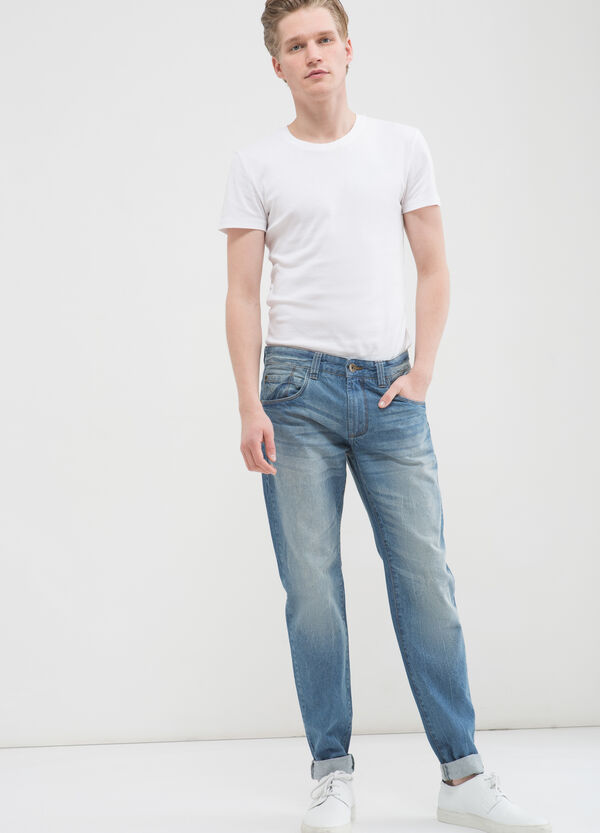 Jeans slim fit effetto used cinque tasche | OVS