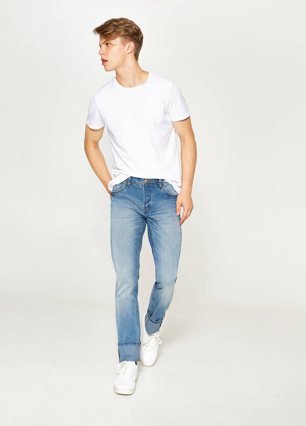 Skinny-fit worn-effect stretch jeans with turn-ups | OVS
