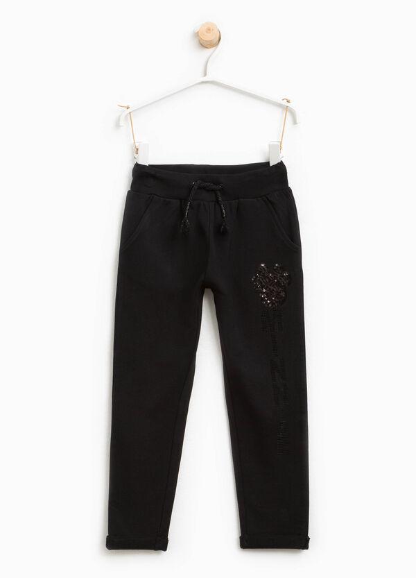 Pantaloni tuta con paillettes e strass | OVS
