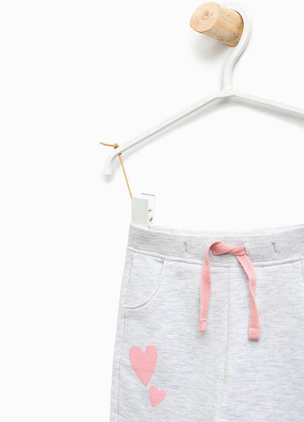 Pantaloni tuta stretch stampa cuori | OVS