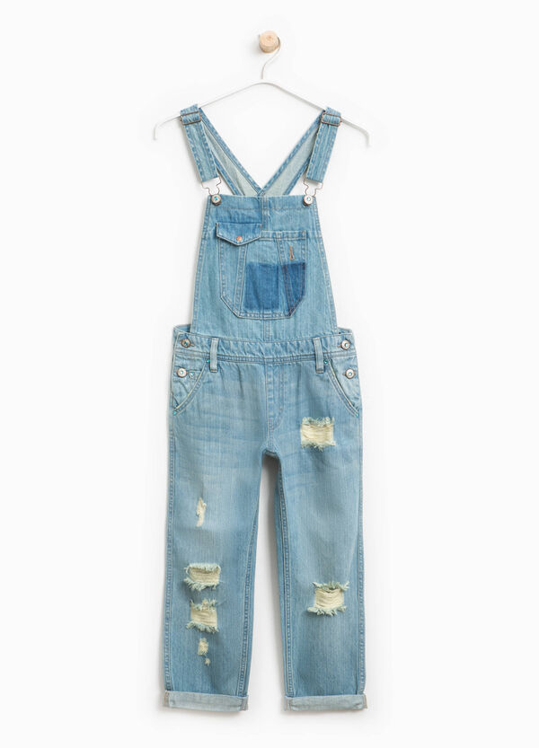 Denim dungarees with rips and whiskering | OVS