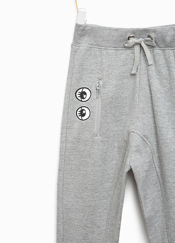 Pantaloni tuta in cotone stampa occhi | OVS