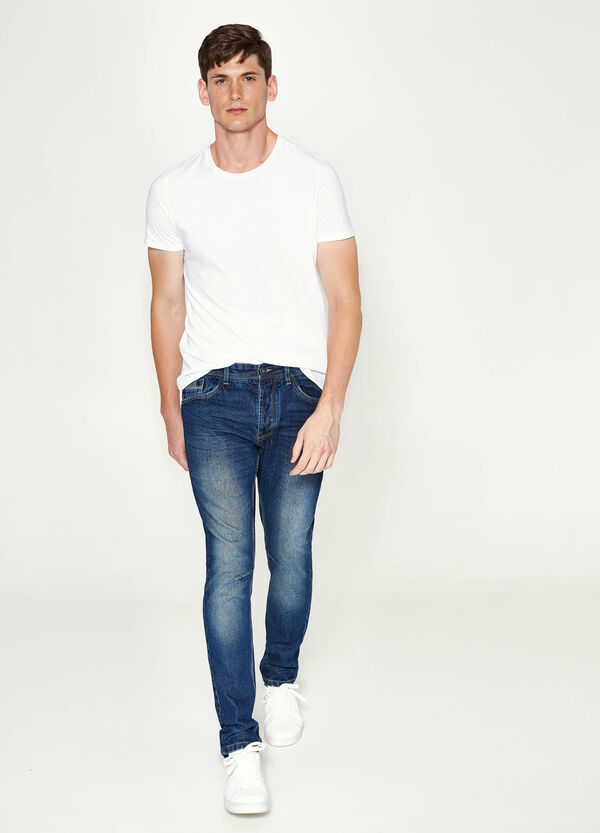 Loose-fit worn-effect jeans with whiskering | OVS