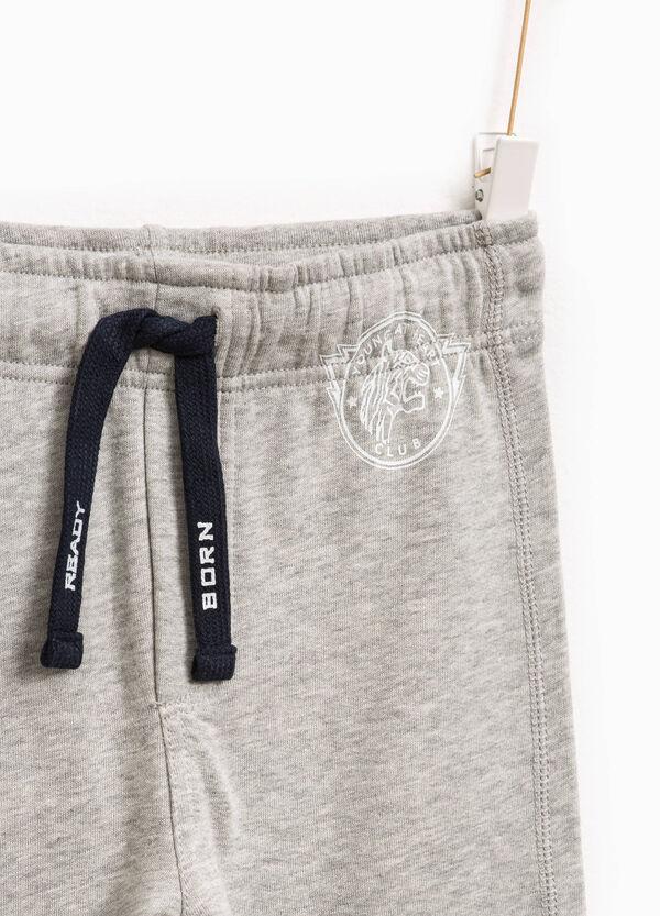 Pantaloni tuta con coulisse e stampa | OVS