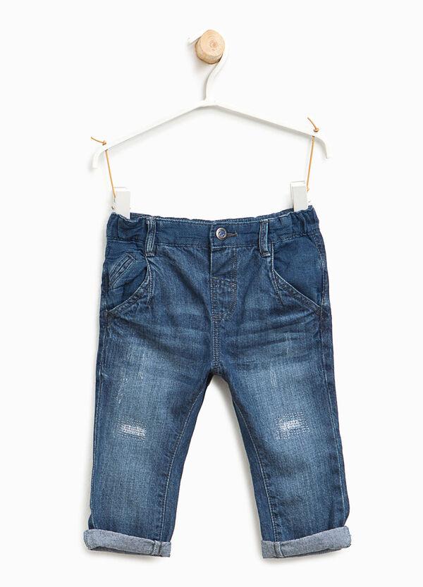 Jeans effetto used con abrasioni | OVS