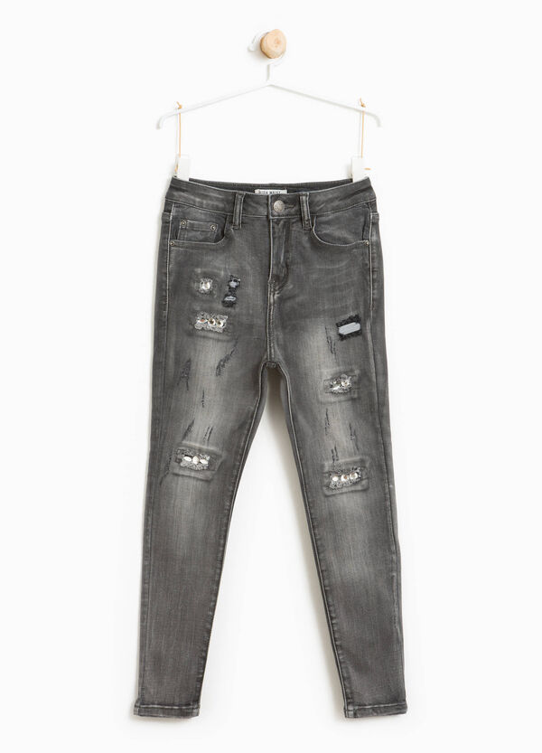 Jeans stretch effetto used con strappi | OVS