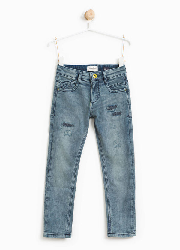 Jeans effetto used stretch con abrasioni | OVS