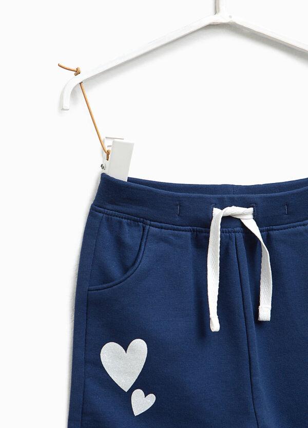 Pantaloni tuta stretch stampa a cuori | OVS