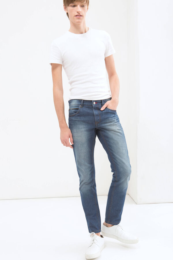 Jeans slim fit con effetto used | OVS